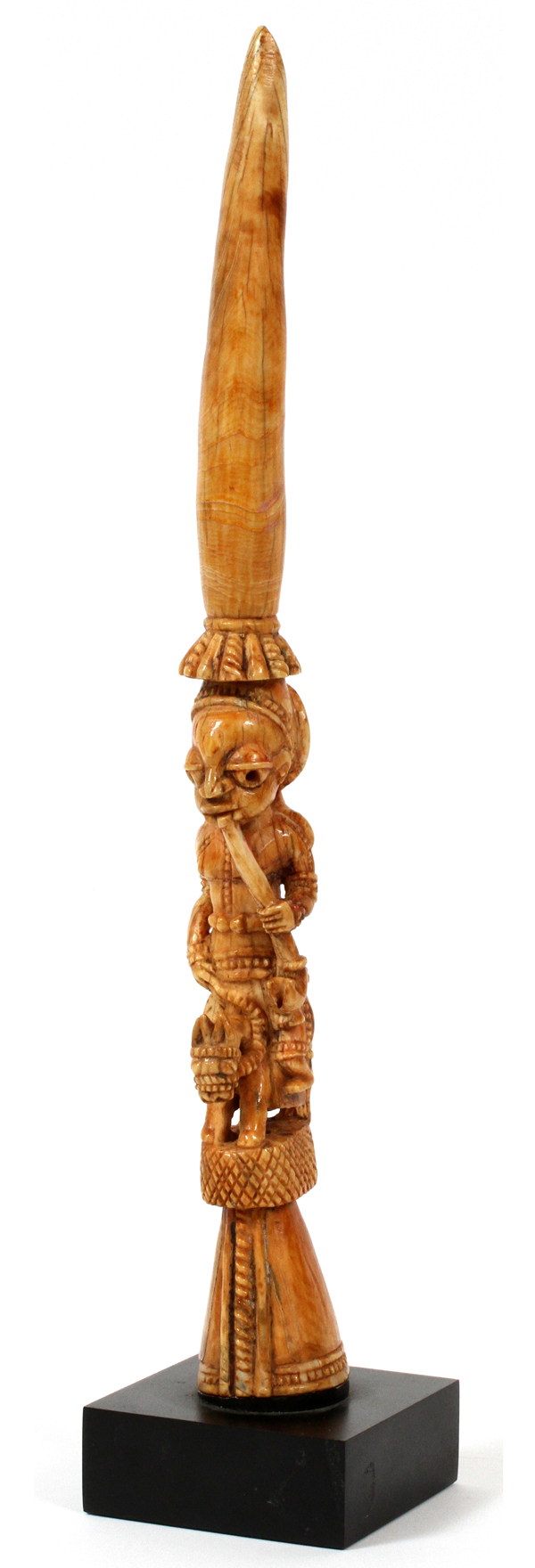 """AFRICAN TRIBAL CARVED IVORY TUSK, L 12 1/4"""": Depicting an elongated figure with pipe, riding a"""