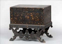 A 19th century lacquered box on stand The rectangular hinged box on a removable scroll carved base