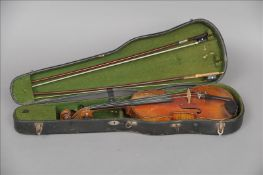 A 19th century French violin With a single piece back, the interior with applied label inscribed