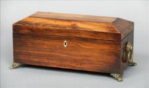 A 19th century Goncalo Alvez tea caddy Of elongated sarcophagus form, the hinged rectangular lid