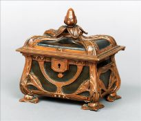 An Art Nouveau Louis Majorelle style patinated bronze and leather casket The finial mounted hinged