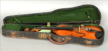 A 19th century violin Of typical form, with label to interior stamped Copy of Maggini, cased and