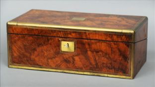 A Victorian brass bound walnut writing slope The hinged rectangular top with a central vacant