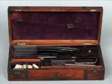 A 19th century brass bound rosewood cased surgeons set The plush lined box housing two layers of