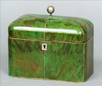 A George III green stained tortoiseshell tea caddy The domed hinged cover with ball finial enclosing