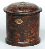 A 19th century Continental faux tortoiseshell tea caddy Of circular section, the hinged cover with