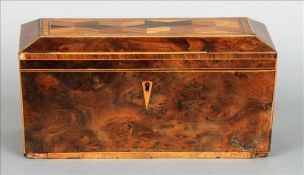 A 19th century parquetry inlaid yewwood tea caddy The hinged lid centred with a panel of geometric
