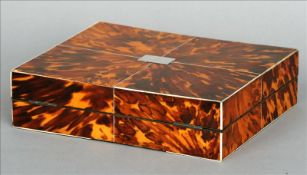 A 19th century tortoiseshell covered shallow box The quarter veneered hinged cover inset with a