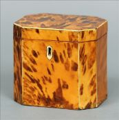 A George III blond tortoiseshell tea caddy Of rectangular form with canted corners, the hinged cover