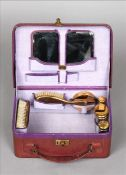 An early 20th century lady`s leather travelling vanity case The hinged rectangular lid enclosing the