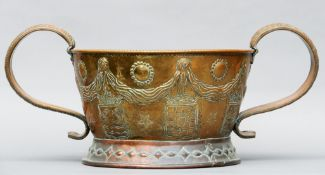 An early 18th century brass repousse decorated wine cooler (possibly Italian) The swag and cartouche