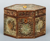An 18th century scroll work tea caddy The hexagonal box with a hinged lid and decorated allover with