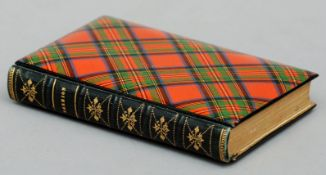 A 19th century tartan ware book cover In the Stuart tartan, the book Marmion by Sir Walter Scott,