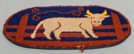 A late 19th/early 20th century hooked rag rug Centred with the figure of a bull. 87 cms wide.