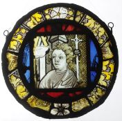 A 14th/15th century stained leaded glass panel Of circular form centred with a portrait panel of a