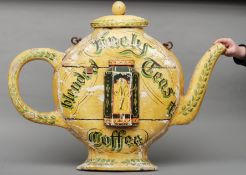 A late 19th/early 20th century painted carved wooden tea shop sign Formed as teapot, the front