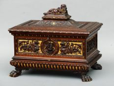 A 19th century Italian carved walnut casket with gilt detail The hinged domed rectangular top
