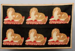 A 19th century repeat needlepoint hanging Of King Charles spaniels seated on embroidered cushions.