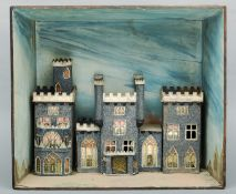 A 19th century decorated cardboard diorama of a castle Housed within a naturalistically painted open
