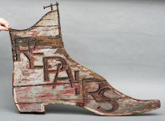 A 19th century double-sided painted wood cobbler's sign Modelled as a ladies boot and inscribed