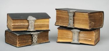 Four Dutch leather bound bibles (possibly 17th century) Each with ornately chased white metal