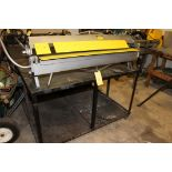 """FINGERBRAKE, 48""""W., 58"""" x 46"""" surface area, large cap. Workforce vise on casters, table mtd. to"""