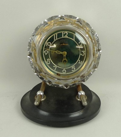 A Maak, Russian, 1930s faceted glass cased mantel clock, green dial bearing Arabic numerals, on a