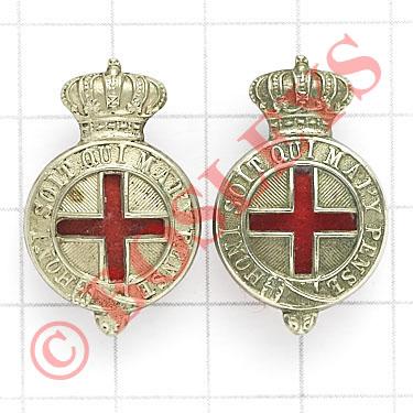 Volunteer Medical Staff Corps pair of collar badges. Die-stamped white metal crowned Garters with
