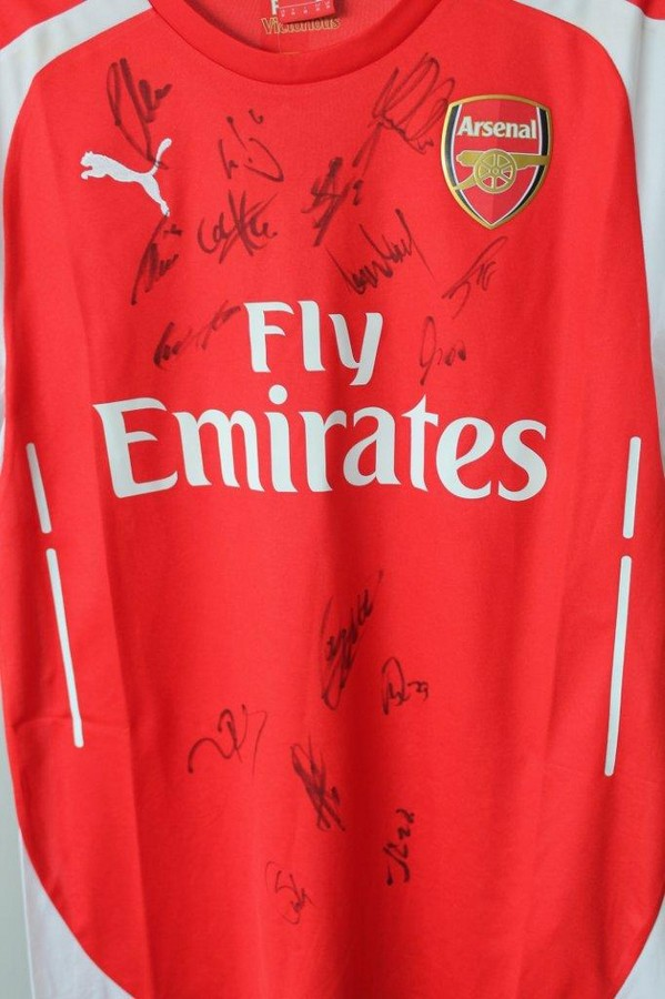 Arsenal FC Signed Shirt This 2014/15 season Arsenal home replica shirt has been donated by Arsenal
