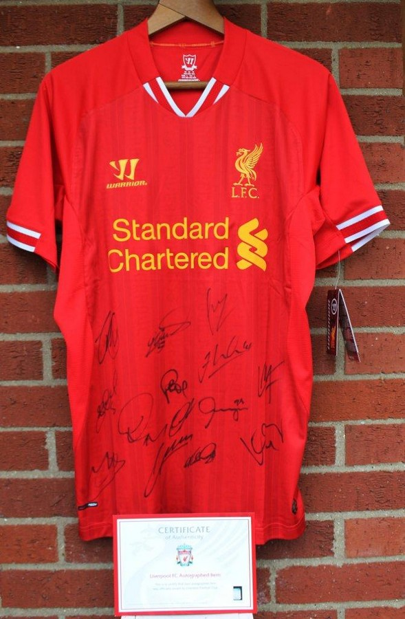 Kindly donated by Liverpool FC. Signed Liverpool FC shirt 2013/14 season Thirteen members of the