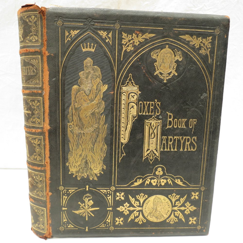 Foxes Books of Martyrs (1873 Ed) in heavily embossed full leather binding with a number of gruesome