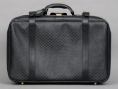 A Gucci suitcase 60 cms wide.   CONDITION REPORTS:  Some scuffing, scratching, general wear.
