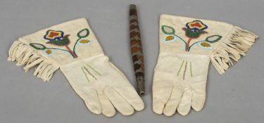 A pair of beaded American Indian gauntlets Each with floral motifs; together with an American Indian