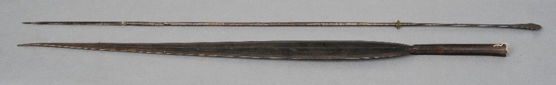 A tribal spearhead, probably African Together with a barbed spearhead.  The former 83.5 cms
