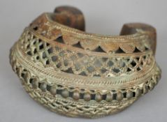 A finely cast early Benin bronze anklet With pierced decoration and good patination.  14 cms wide.