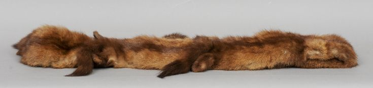 A mink stole, retailed by Harrod's Limited, London Bearing label.  224 cms long.   CONDITION