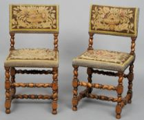 A pair of 18th century style tapestry covered barley twist chairs Each covered with floral