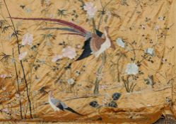 A Chinese embroidered silk bedspread The peach ground decorated with various birds and insects
