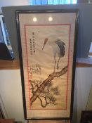 CHINESE SCHOOL (20th century) A silkwork picture Worked with a perched crane, calligraphic script