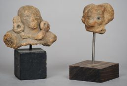 Two Pre-Columbian pottery fragments Each mounted on a later display stand.  The largest 6.75 cms