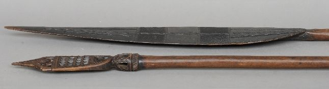 A pair of 19th/20th century carved wood canoe panels, possibly Oceanic Each blade geometrically