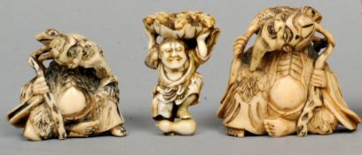 An ivory netsuke Carved as a sage with a toad on his back; together with another, similarly carved