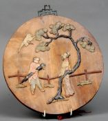 A late 19th/early 20th century Chinese soapstone inlaid wooden plaque The circular body mounted with