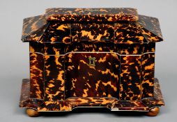 A 19th century tortoiseshell tea caddy The shaped rectangular hinged top enclosing two lidded