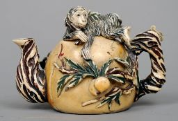 A Chinese carved ivory teapot Of organic form, the lid carved as a reclining monkey, the main body