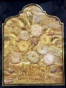 An 18th/19th century silk and lacework picture Worked as a basket of flowers, framed and glazed.  43