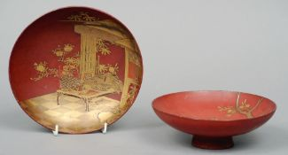 Two late 19th century Japanese lacquered dishes Each with gilt decoration, on a rouge ground,