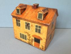 A finely painted Naive early Victorian sewing box, in the form of a cottage The hinged lid enclosing