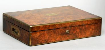 A Victorian brass bound burr walnut humidor The brass banded hinged rectangular top centred with