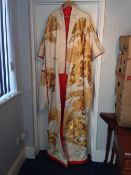 A Chinese gold thread embroidered robe Decorated with cranes amongst foliage.  Approximately 165 cms